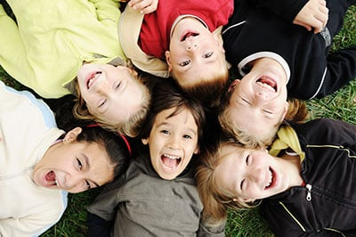 Happiness without limit, happy group of children in circle, together outdoor, faces, smiling and careless